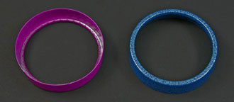 Customized die stamping is perfect for commercial packaging applications such as these powder finished metal grip rings